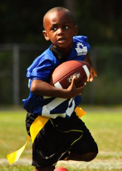 Young boy playing flag football