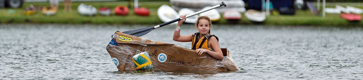 Girl participating in the Cardboard Canoe Race