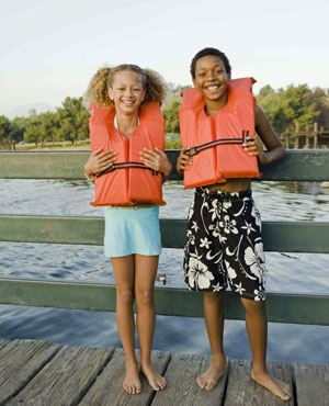 two children wearing lifejackets