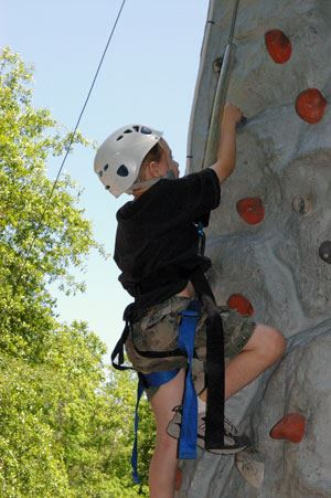 Young boy on the Climbing Wall