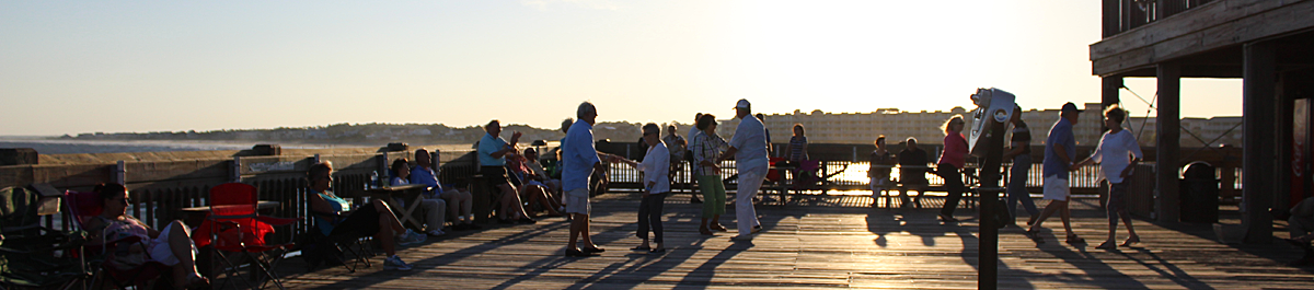 People dancing at Moonlight Mixer at the Folly Beach Pier