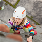 girl climbing on the portable climbing wall