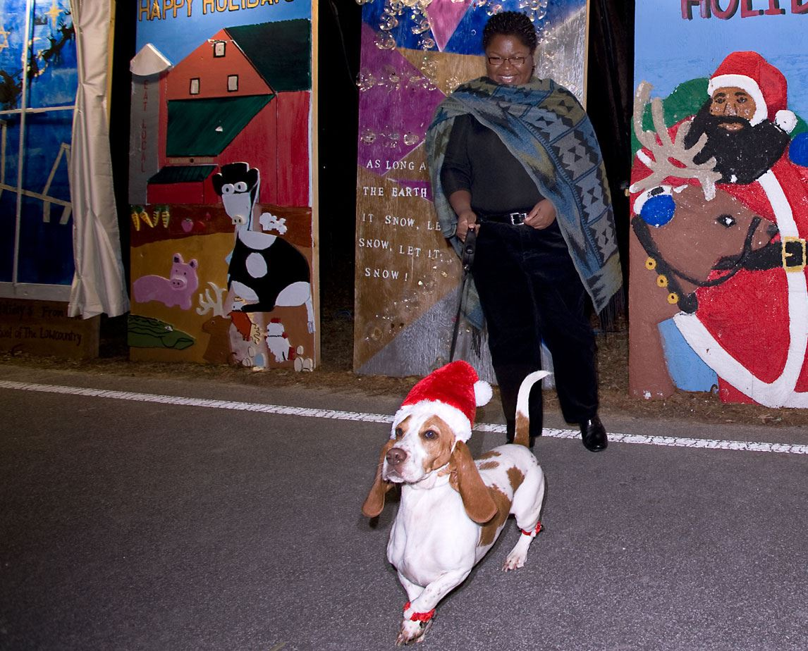 A woman and her basset hound at the Holiday Festival of Lights