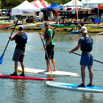 Image of 3 men on stand up paddleboards