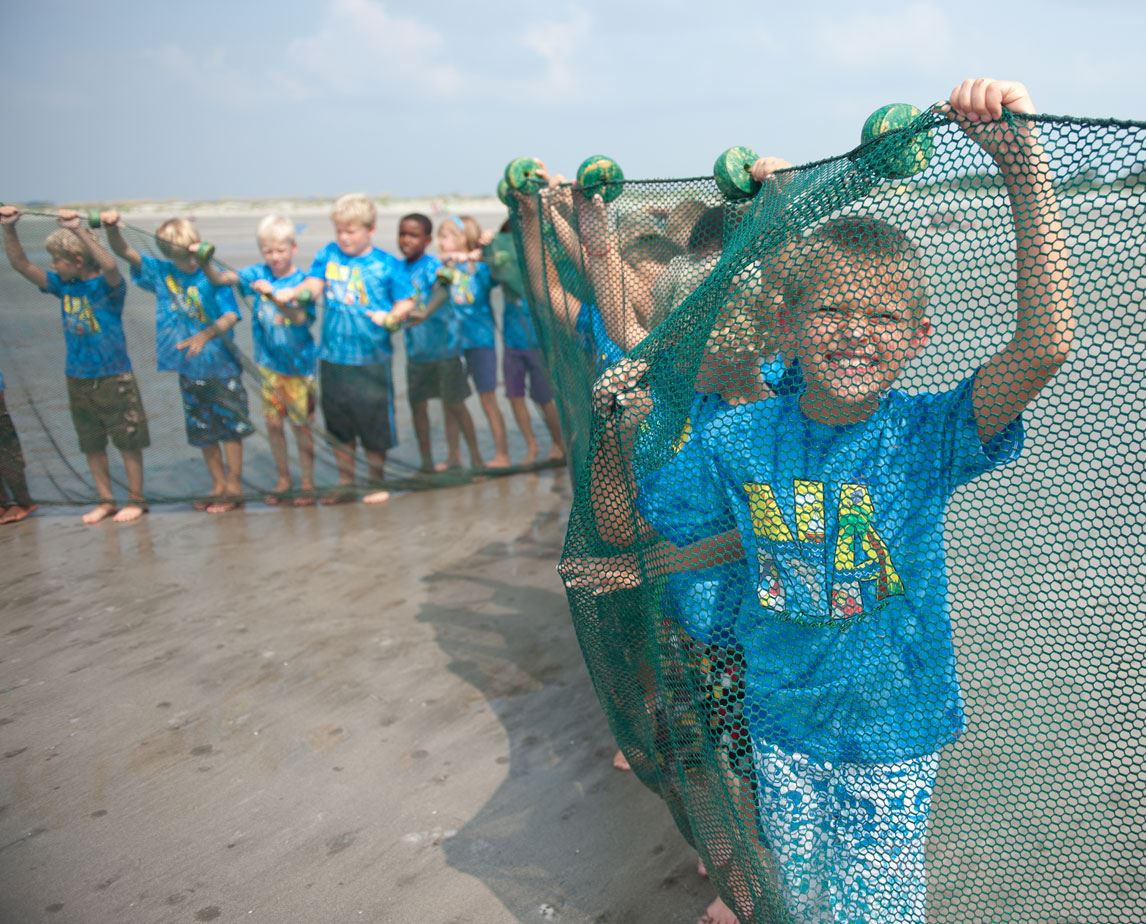 image of kids participating in the Junior Naturalist program on the beach