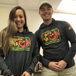 two staff members wearing black hooded t-shirts with the Chili 5K logo