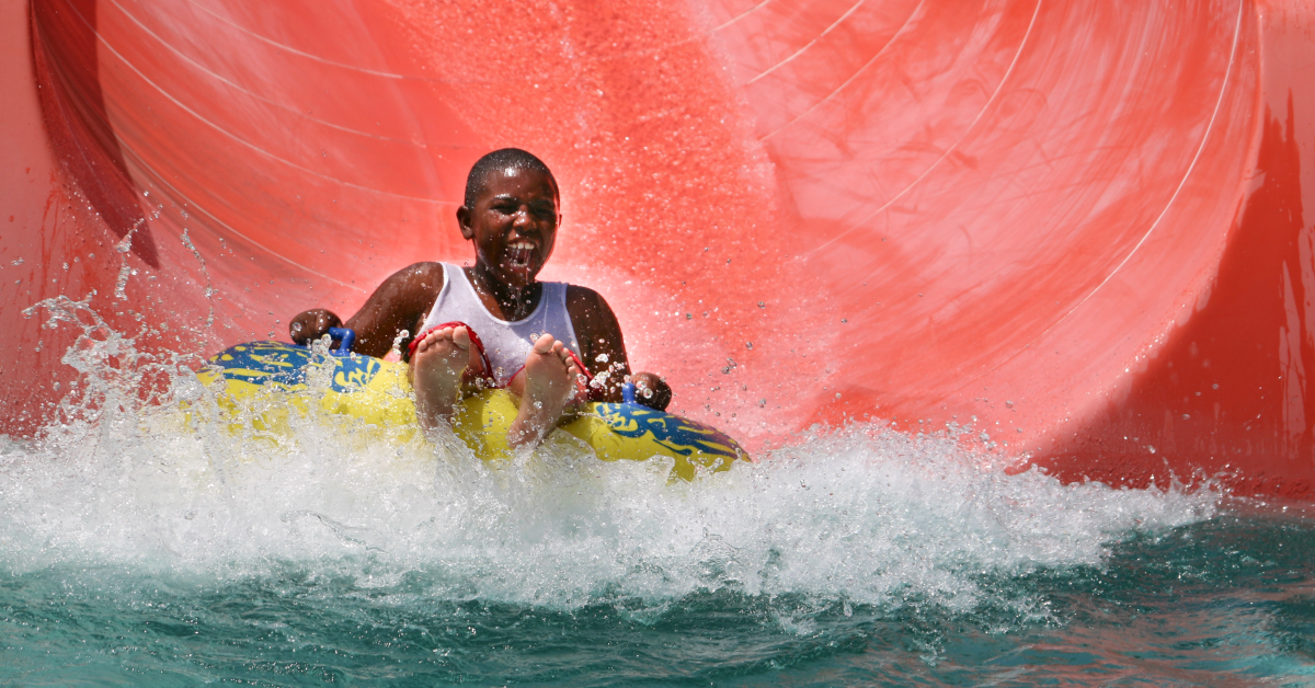 Child on an innertube sliding down a waterslide