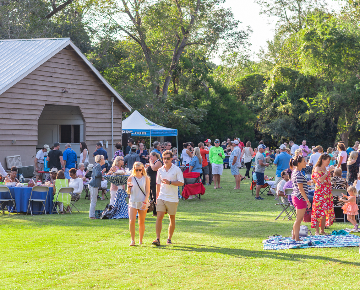 People walking the grounds of Old Towne Creek County Park at Wine Down Wednesday