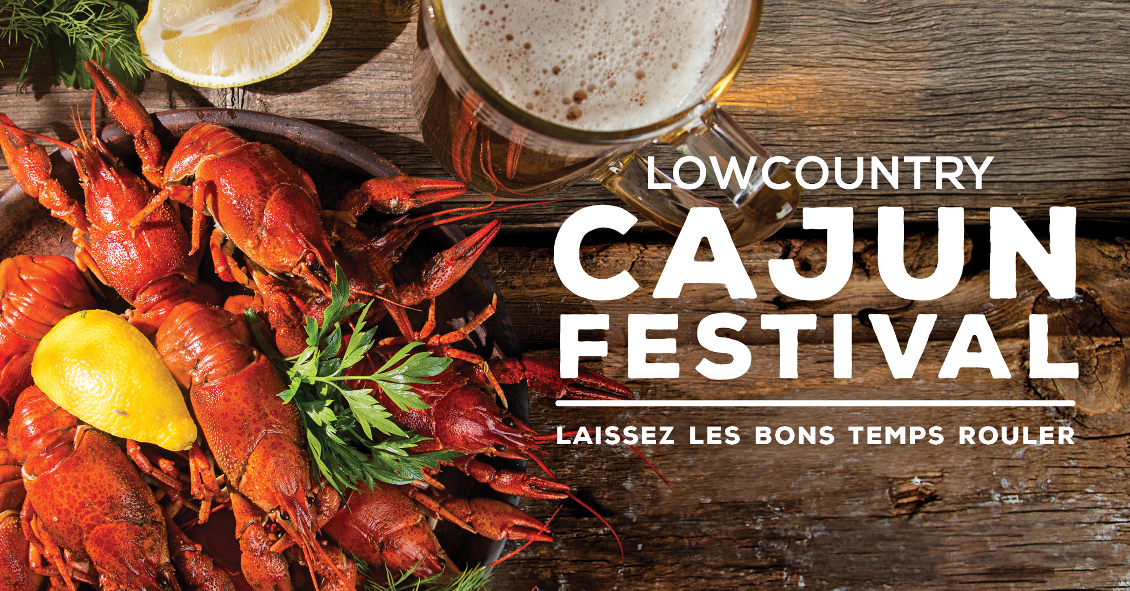 Lowcountry Cajun Festival image of boiled crawfish and a pint of beer on a wooden table top