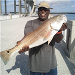 Smiling man with 29in Redfish