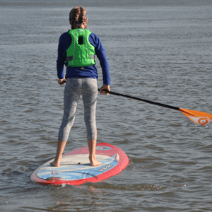 Woman on a stand up paddleboard on the water