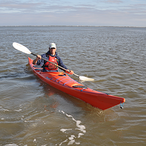 Man in a kayak during a Coastal Kayaking class