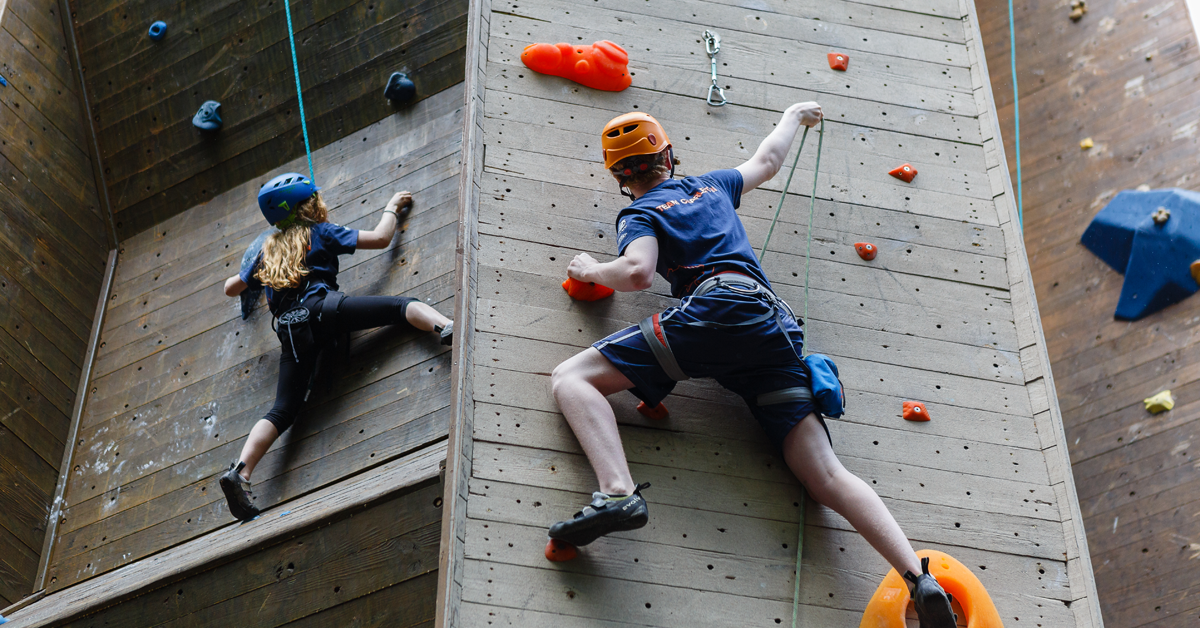 Two Climbing team members climbing the wall