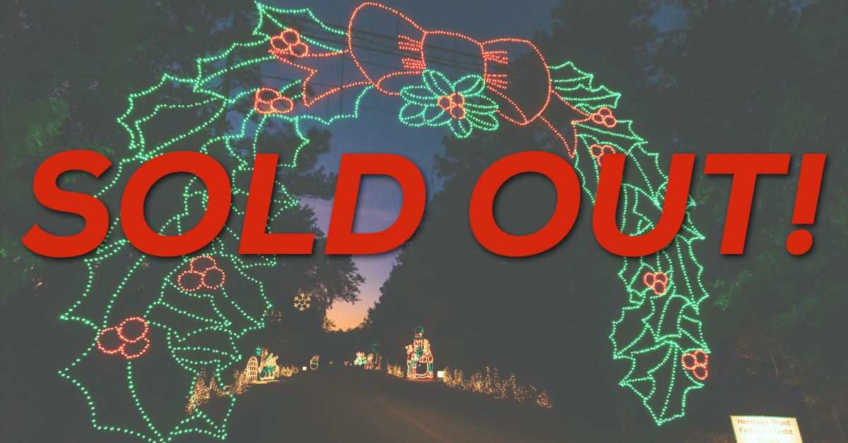 Sold Out - Lighted wreath arch over the road at the Holiday Festival of Lights