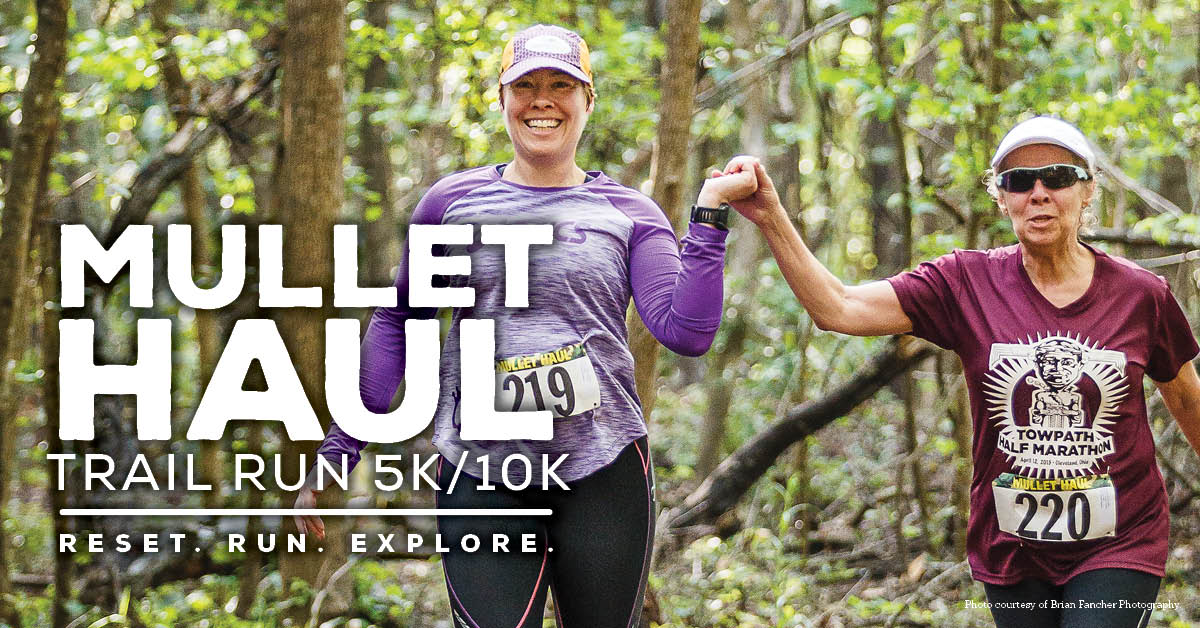 Two women holding hands while running at the Mullet Hall Trail Run