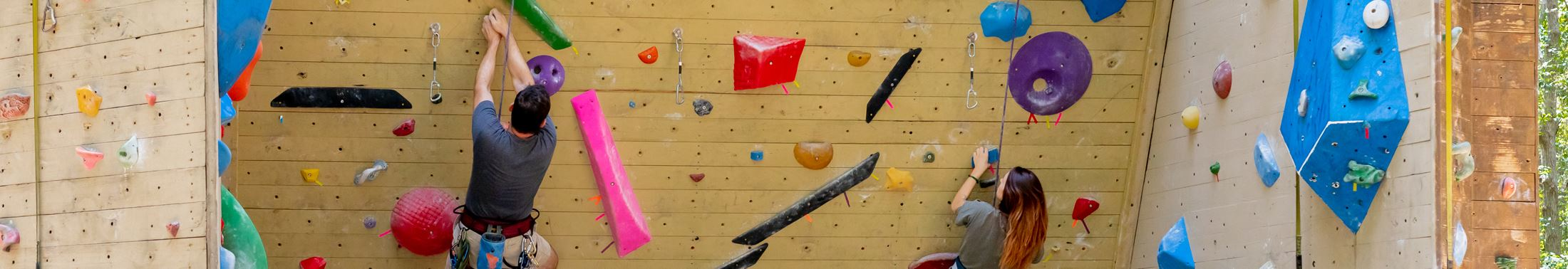 Two climbers at the Climbing Wall at James Island County Park