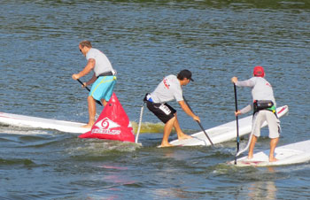 One Design Sup Racers Paddling Around a Bouy
