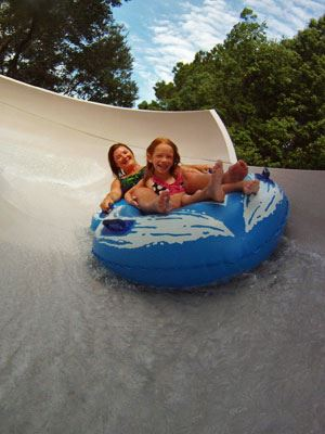 Image of people on a slide at Splash Zone Waterpark