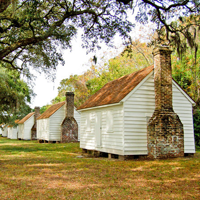 Small white wood Houses of the enslaved at McLeod Plantation Historic Site