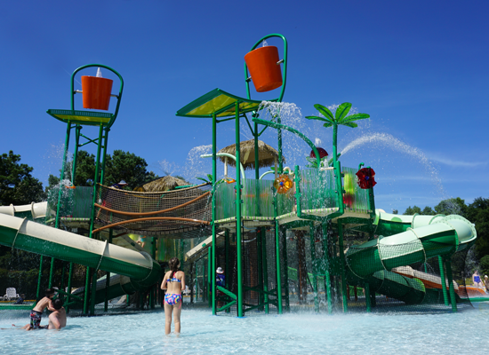 Children playing around the Rainforest attraction at Splash Zone Waterpark