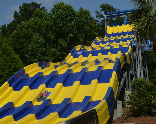 People sliding on mats down the Riptide Run