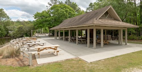 The covered Wappoo Shelter with picnic tables underneath