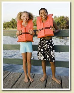 Image of 2 children wearing PFD's