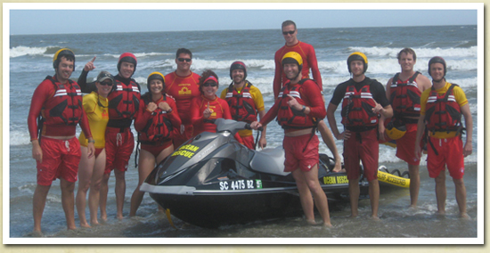 Image of a group of CCPRC Lifeguards and Instructors on the beach