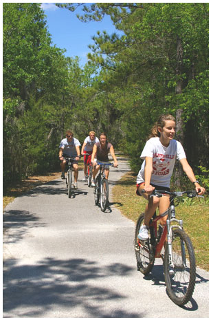 Image of 4 people riding bikes at James Island County Park